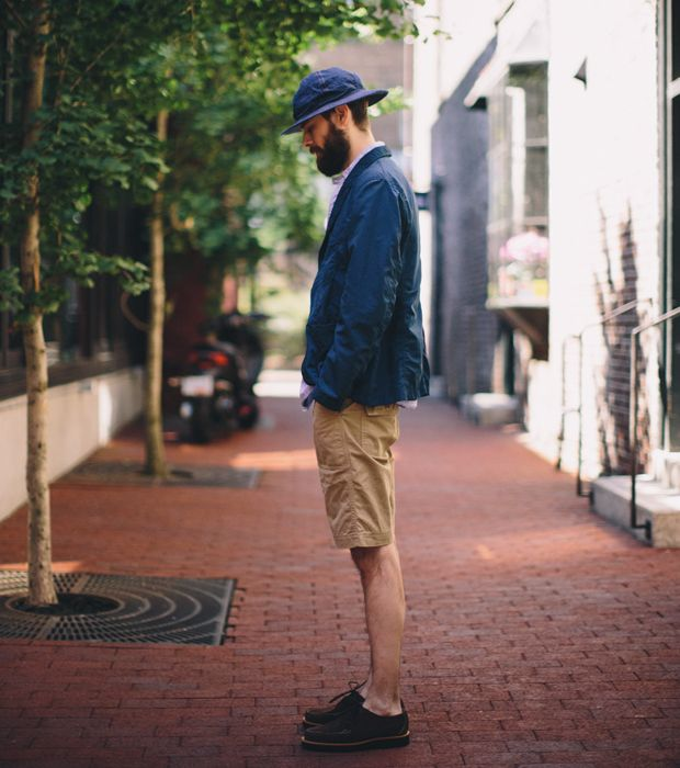 """Inventory Magazine - SS13-001LOOK 001  Hat orSlow  Jacket Engineered Garments  Shirt Post Overalls  T-shirt Champion for The Real McCoy's  Shorts Workers  Shoes Yuketen for Inventory  Matthew (6'4"""", 145lbs) is wearing Medium in Engineered Garments and Post Overalls, Large in The Real McCoy's, and Small in Workers."""