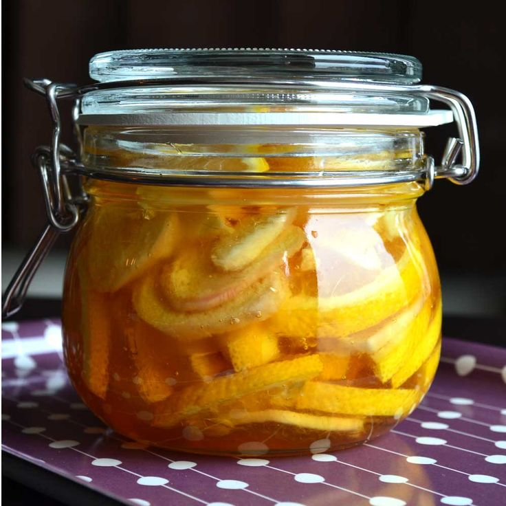 Preserving Lemons and Ginger in Honey, delicious natural cold remedy but also makes an EXCELLENT hot toddy!!  A spoonful of this, straight from the jar or in your tea (or hot toddy!!) will help soothe your scratchy throat in a jiff!