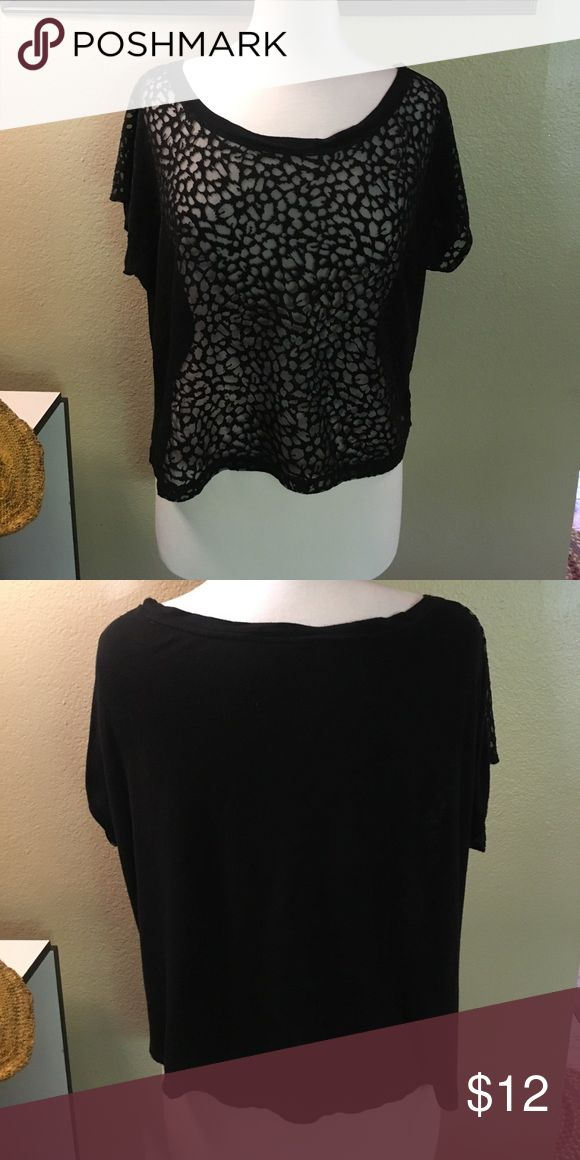 Chloe K Animal Print Top Very cute too! Will need a cami underneath and the color will show through in the print. Short sleeved. Sits at waist. Back is T-shirt material. Reposh. Chloe K Tops Tees - Short Sleeve