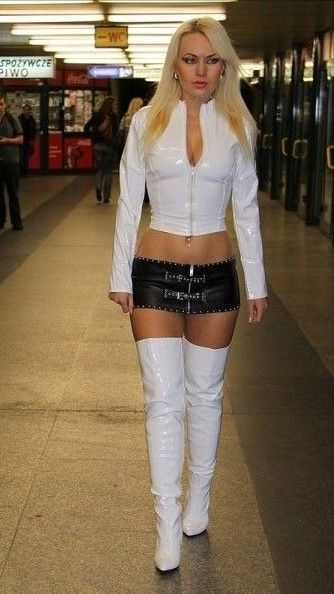 Blonde In White Thigh Boots White Pvc Top And Black Micro