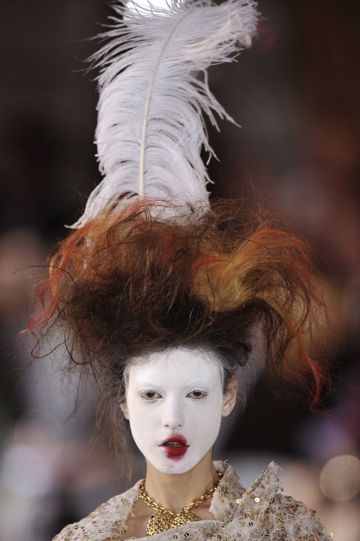 Vivienne Westwood.....mad QE l. you have to love westwood's creativity.