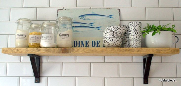 See how I resurfaced an old scaffold plank do make these rustic kitchen shelves!