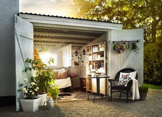 Turn a small garage or shed into a cozy reading nook. What a great backyard retreat.