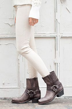 all white and iconic Frye harness boots