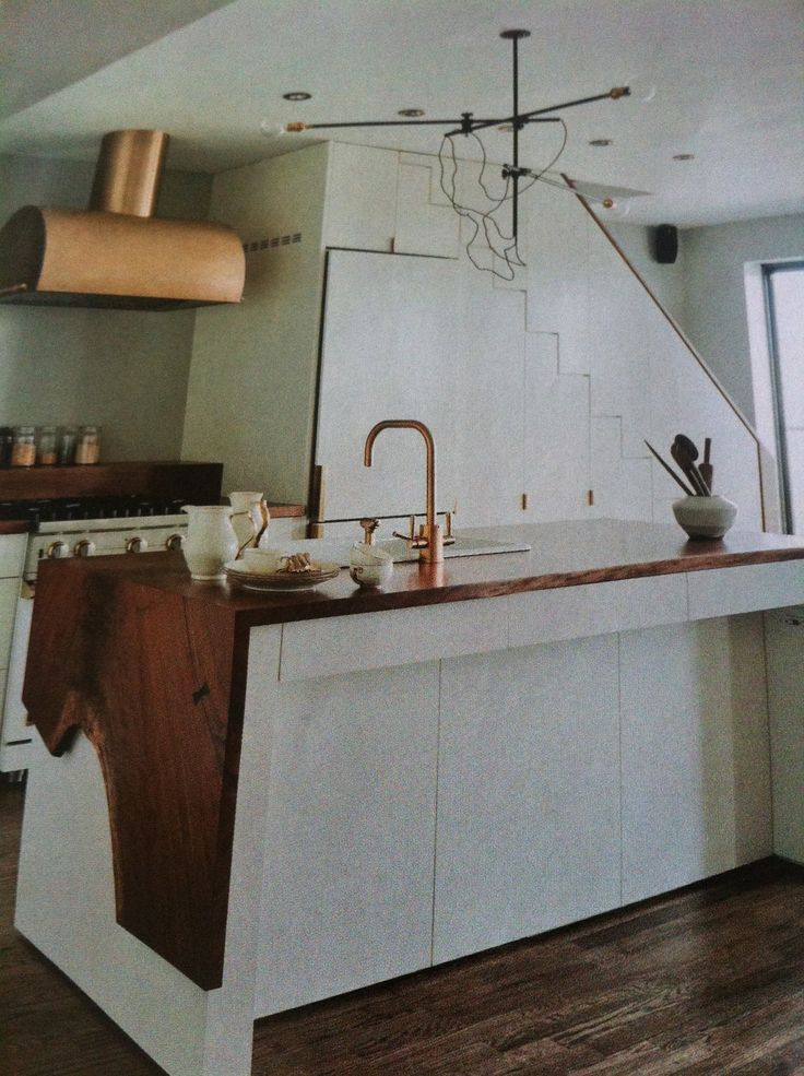 Natural wood worktop & copper tap