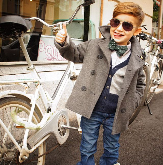 Pea Coat. Side Part. Thumbs Up. Should be a Motorcycle. Too cool.