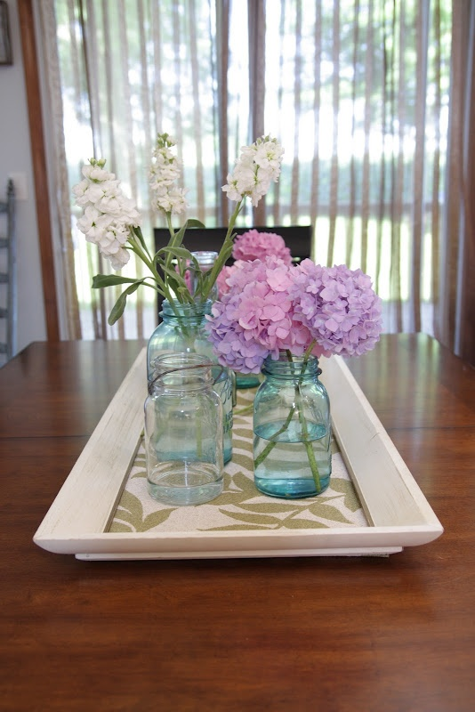 How to make a table centerpiece. Use an old picture and turn it into a centerpiece tray for your table you could line with decorative paper or paint (chalk board) I love the mason jars with flowers
