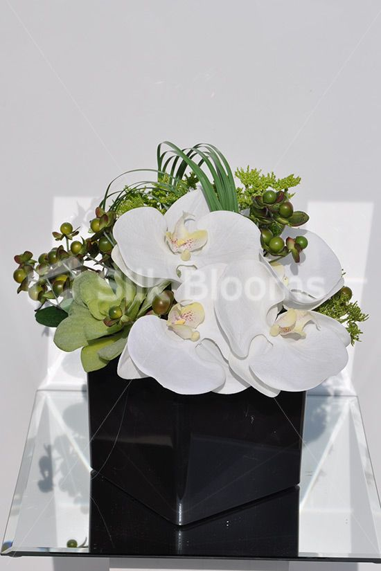 1000 images about christmas home decor flowers on Christmas orchid arrangements