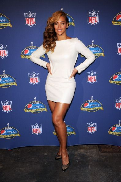 #Beyonce wearing Olcay Gulsen white lamb leather dress with a slit partial open back and Jimmy Choo lace mesh 'Barb' pumps at the Pepsi Super Bowl XLVII Halftime Show Press Conference at the Ernest N. Morial Convention Center on January 31, 2013 in New Orleans, Louisiana.