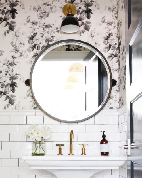 Black floral wall paper white subway tile and gorgeous mirror