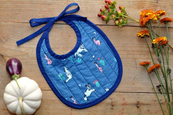 Make mealtime all the sweeter with this heirloom-quality bib in gender-neutral aqua and navy prints.  I was inspired by a vintage family heirloom
