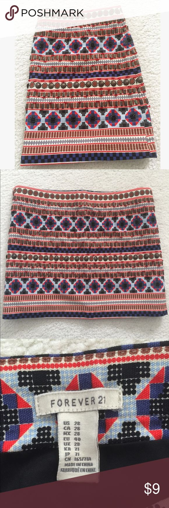 Aztec Print Skirt Adorable beaded aztec mini skirt. A few loose beads but otherwise good condition! Forever 21 Skirts Mini