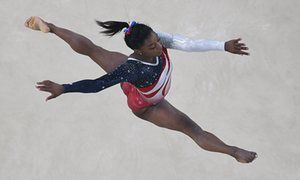 US gymnast Simone Biles competes in the Floor event during the women's team final Artistic Gymnastics at the Olympic Arena during the Rio 2016 Olympic Games in Rio de Janeiro on August 9, 2016. / AFP PHOTO / Antonin THUILLIERANTONIN THUILLIER/AFP/Getty Images