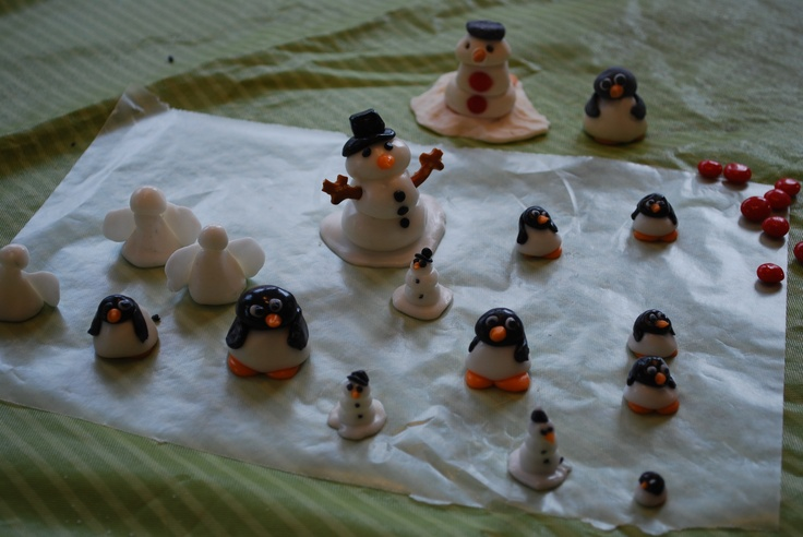 Make these adorable penquins, snowmen and angels from Sugar Paste- just mix powdered sugar+egg white+corn syrup to form the dough. Color some black and some orange. I only use gel colors and use crisco to grease your hands so it doesn't stick. You can eat them or let them dry and keep them for years! A great addition to the Gingerbread Village!