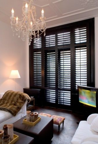 Black plantation shutters. Nice! Woonkamer - Jasno Shutters & Blinds  I would add a plant :) #home #decor