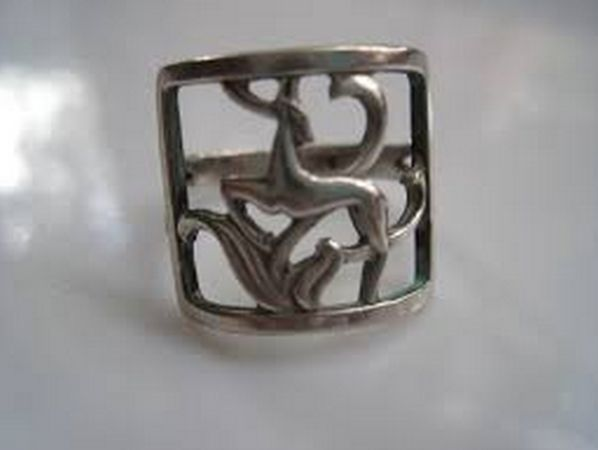 I B Jensen. Openwork silver ring with deer design. 830 silver. Marked 'BJ' and 830S. View 1/4.
