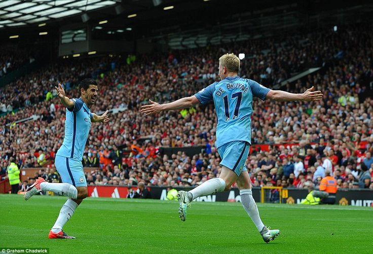 Kevin De Bruyne (right) wheels away in celebration after opening the scoring for Manchester City