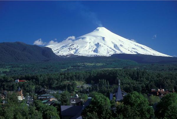 Villarrica Volcano, Chile.     Amazing climb and amazing views from the top. Just don't fall in :)
