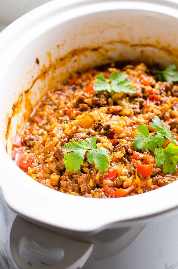 Stuffed Pepper Casserole made in a slow cooker with bell peppers, brown rice, ground turkey and tomato sauce. Simple unstuffed lazy peppers recipe. | ifoodreal.com
