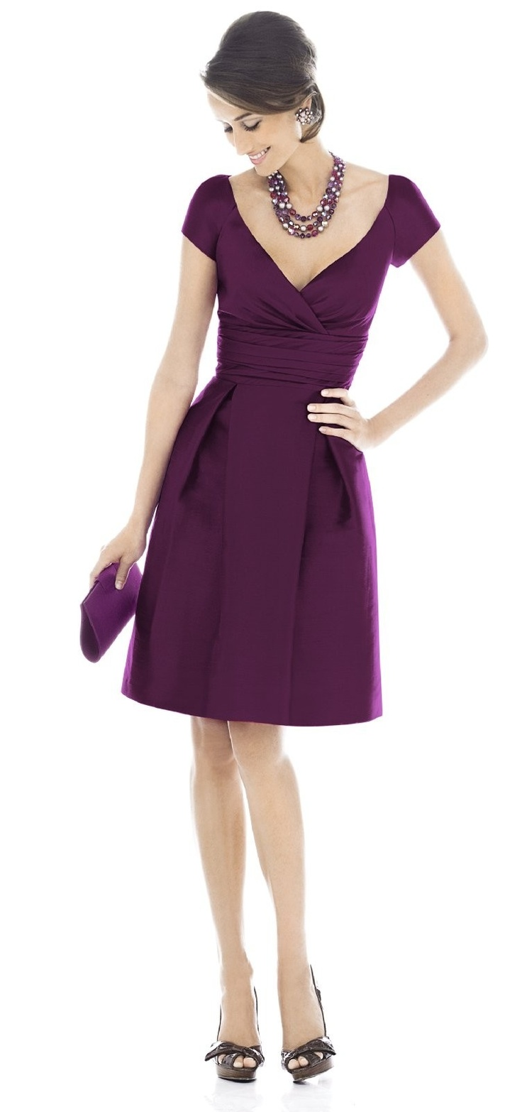 Alfred Sung  Style D502 Bridesmaid Dress  V-neck cap sleeve cocktail length dress in Peau de Soie has pleating at bodice and rouched inset midriff at natural waist. Pockets at side seams of skirt. $190.00 1072 - Italian Plum