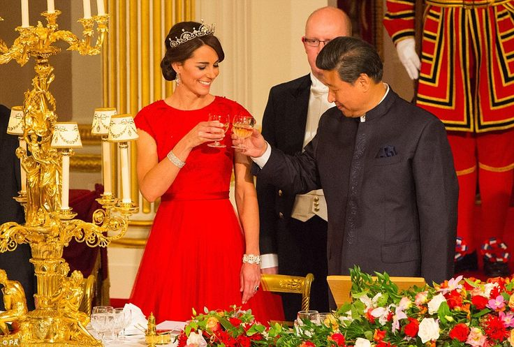 The Chinese national anthem played as the guests, assembled at Buckingham Palace's lavishl...: