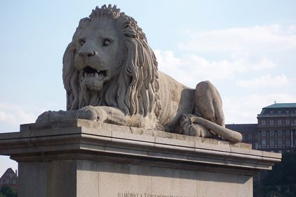 Ferocious lions by sculptor Marschalko János guard the entrance to the Chain Bridge. - See more at: http://travelcuriousoften.com/october13-feature.php#sthash.MFiNEcjz.dpuf