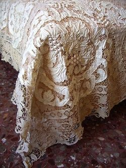 I have this tablecloth hanging as a curtain over large tub in bathroom!Exquisite!