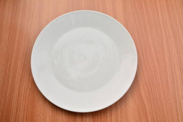 empty plate on wood table background view from above