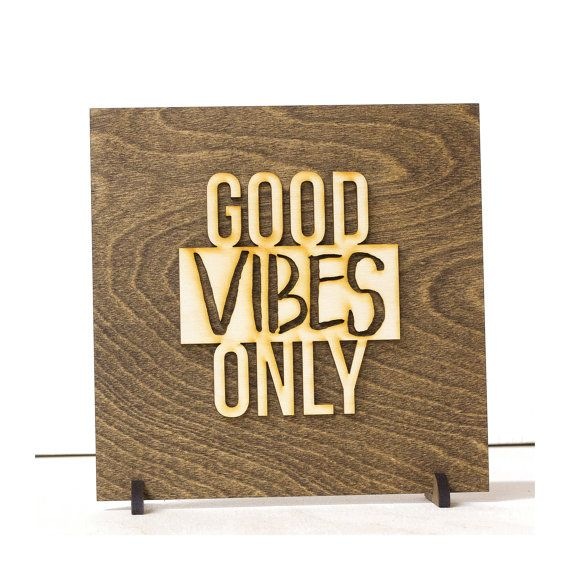 Good Vibes Only  Laser Cut Wooden Wall Banner  DETAILS ---------------------  Materials // Birch Wood & Suede Cord Banner Size // 7.75 x 5.5 (not including suede cord) Standing Size // 6.5 x 6.5 (not including feet)  Artwork is designed and laser cut in our small shop located in Washington State. Sign is backed with 1/4 plywood and wording is cut from 1/8 birch. Standing signs come with two laser cut feet that slip onto the sign to make it a perfect...