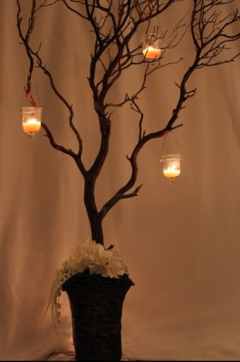 centerpiece!! branches and candles on 9 tables