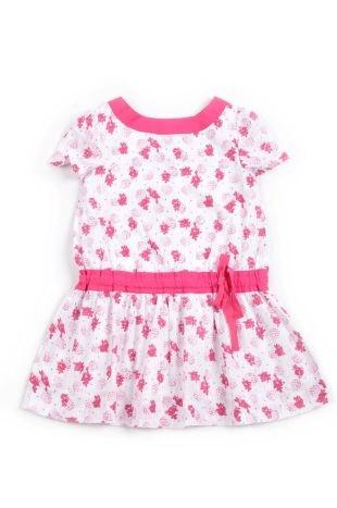 Vestido para niña, en color blanco y estampados en color fucsia. Cuello redondo y mangas cortas.