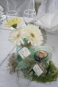 Antique mason jars with gerbera daisies and wine corks
