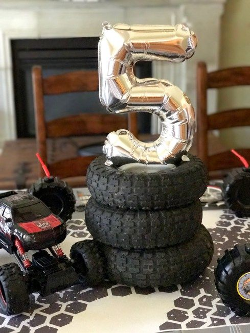 Super easy but fun centerpiece for a Monster Truck Birthday Party Smash! Halfpint Design with Party Printables from HalfpintPartyDesign on Etsy. Boy party theme. 5th birthday. Easy Party Centerpiece.