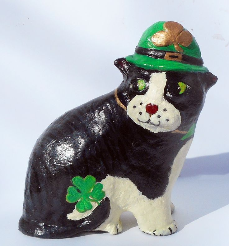 "Flynn the Lucky Shamrock Kitty - Whimsical Paper Mache Clay Cat Sculpture. Flynn the Lucky Shamrock Cat is a fun loving kitty measuring 9"" T x 3.5 D x 9"" L He was created over a wire/cardboard armature, covered with a special paper mache clay, plaster of paris gesso then lovingly hand painted with acrylic paints protected with a Krylon acrylic sealant. He is one of a kind, signed and dated. He would love to be part of your cat collection :-)."