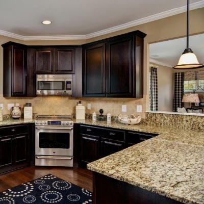 Dark cabinets and light granite counter tops