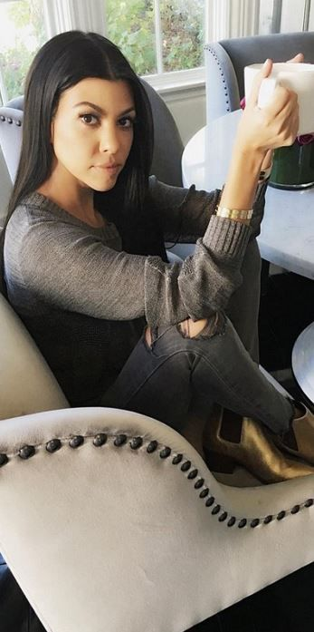 Kourtney Kardashian: Bracelet – Cartier  Jeans – J Brand  Shoes – Saint Laurent