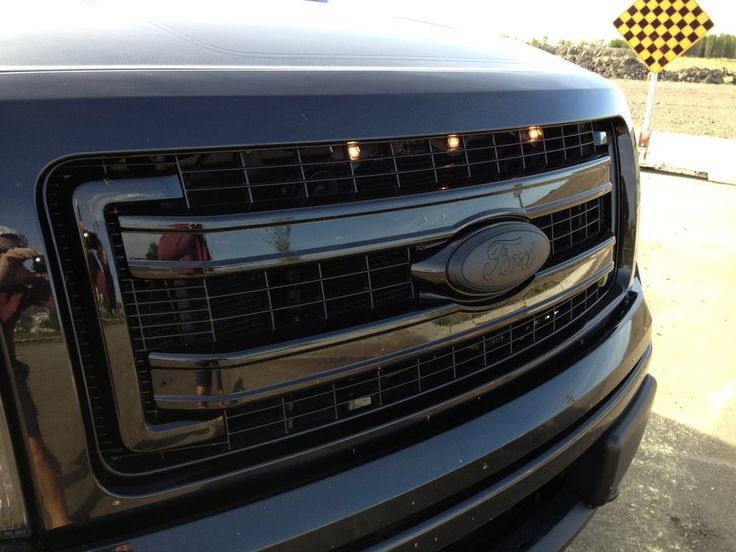 2013-2014 Raptor Style Grill Light Kit for 2013-2014 F150. Fits ALL grill styles. XLT-LT -Super cab-Reg cab -Super crew -4x4-4x2 No drilling, bolts onto existing grill studs. Comes complete w/everything needed for install. Made by #CustomAutoWorks http://www.customautoworksstore.com/home.html #Ford #trucks #raptorstyle #lightkit #F150Grill #RaptorLED #F150Raptor