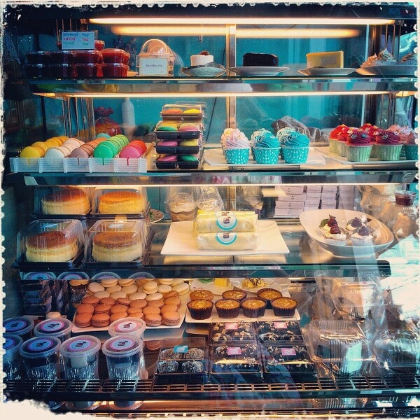 Bakery showcase collection, color of macaroons and cupcakes