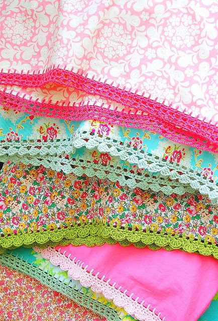 I adore  the crocheting on the pillowcases.