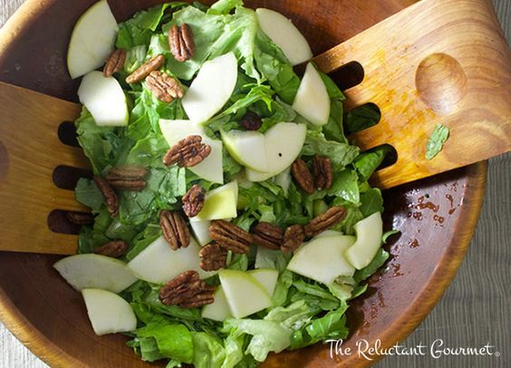 Learn how to make a simple apple, pecan and bib lettuce salad with a Dijon, maple syrup vinegraitte to serve with your favorite meals.