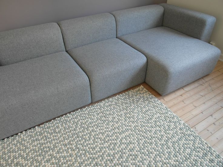 This is a carpet designed for molekule by a Norwegian blogger Andrea Gravningen. It is so beautiful in its simplicity.Andrea  used just two colours: white and very light grey. The photo is from our living room to show how Andrea's carpet looks next to the grey sofa. #sofa #grey #carpet #molekule #kuleteppe #feltballrug #ballrug #livingroom