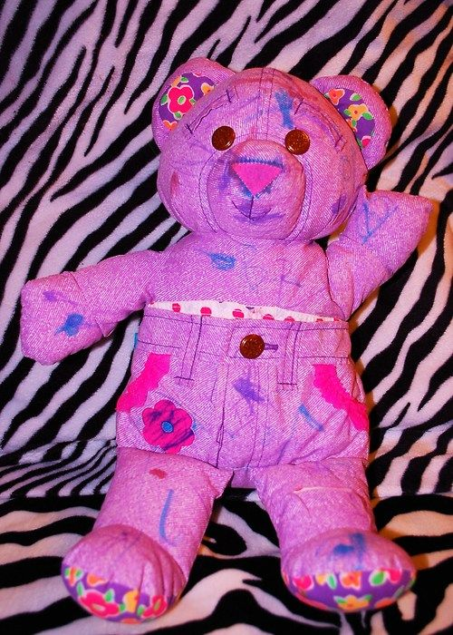Doodle Bear- I had a blue one. My friend Aaron and I gave it tattoos. One of those tattoos was an eye with a nail through it. I was a tomboy......