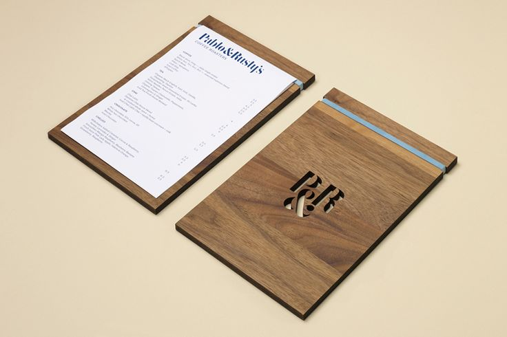 Menu design with wood backboard for coffee shop and roaster Pablo & Rusty's designed by Manual