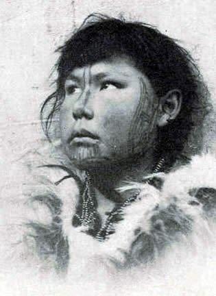Inuit girl with facial tattoos - circa 1900