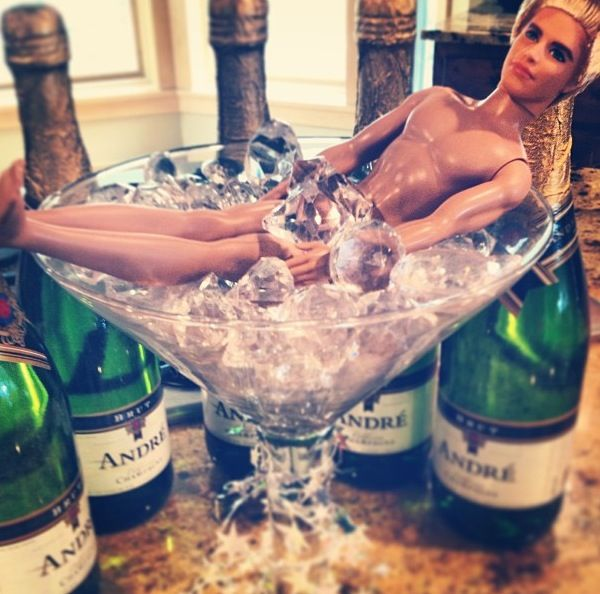 Funny!  Bachelorette centerpiece More so the diamonds in a martini class than the ken doll...but maybe! Haha