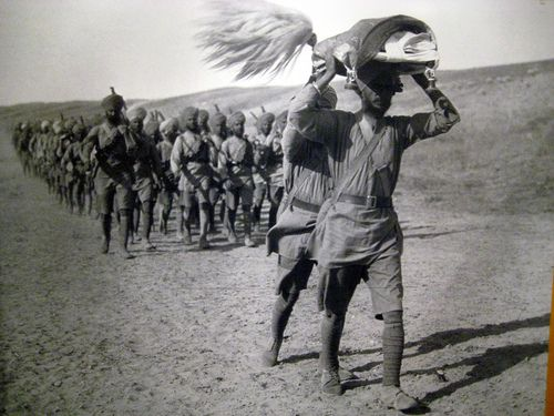 The Sikh Regiment, being led by Sri Guru Granth Sahib, of the British-India Army somewhere in the Asia Minor front (more or less the area that is the modern day Middle East—Iraq, Syria and Turkey) during World War I.