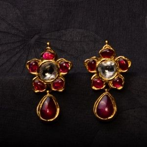 Ruby Dreams - Rubies form the highlight of this pair of earrings, with a hint of uncut diamonds, handcrafted in 22k gold.