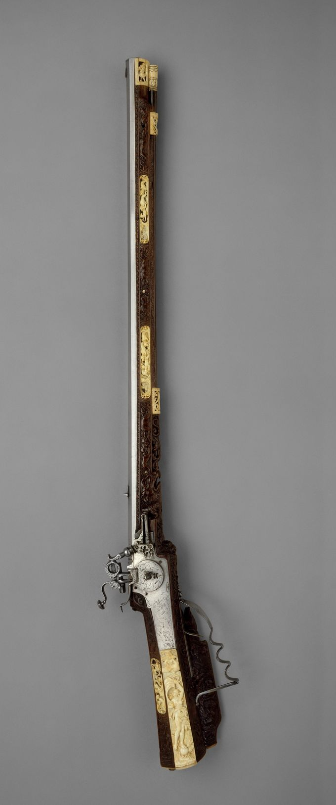 Wheellock rifle. Johann Michael Maucher (German, Schwäbisch Gmünd, 1645–1701).  Date:     ca. 1680–90. | © 2000–2014 The Metropolitan Museum of Art.