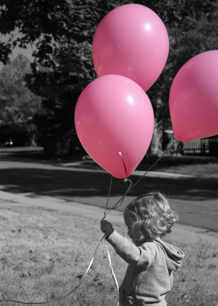 Black and white picture with colored balloons
