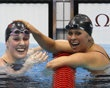 Missy Franklin of the U.S. celebrates with team mate Elizabeth Beisel after they took gold and bronze in the women